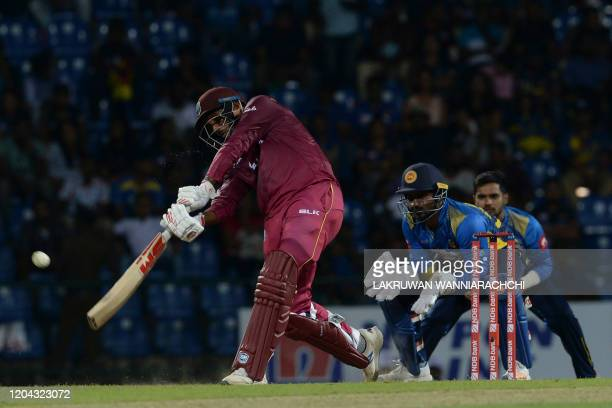 West Indies Sunil Ambris plays a shot during the third one day international cricket match between Sri Lanka and West Indies at the Pallekele...