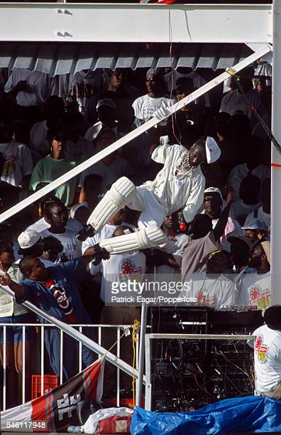 West Indies 'superfan' Gravy goes through a routine during the 6th Test match between West Indies and England at the Recreation Ground St John's...