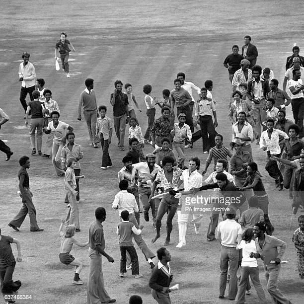 West Indies supporters invade the pitch after their convincing victory.
