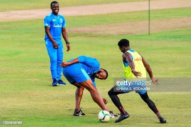 West Indies' team captain Kieron Pollard plays football with teammates during a practice session at the Pallekele International Cricket Stadium in...
