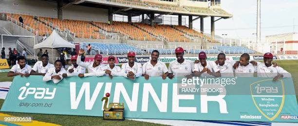 West Indies team pose for pictures with the winners trophy at the end of day 3 of the 2nd Test between West Indies and Bangladesh at Sabina Park...