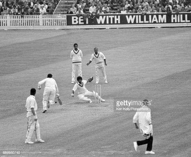 West Indies wicketkeeper Deryck Murray attempts unsuccessfully to run out England opening batsman Geoffrey Boycott during the first innings of the...