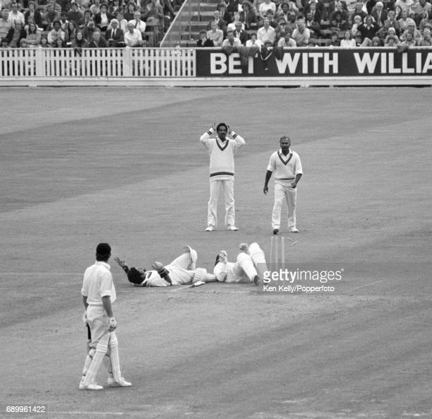 West Indies wicketkeeper Deryck Murray collides with England opening batsman Geoffrey Boycott after an unsuccessful attempt at a runout during the...