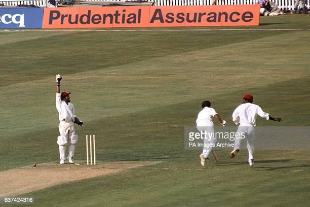 West Indies wicketkeeper Jeffrey Dujon celebrates as Australia's Alan Turner is run out by Viv Richards