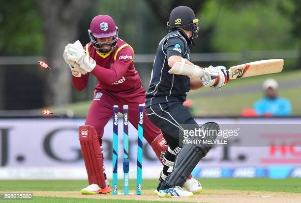 TOPSHOT West Indies wicketkeeper Shai Hope stumps New Zealand's Tom Latham during the third oneday international cricket match between New Zealand...