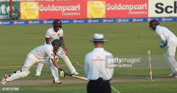 West Indies' wicketkeeper Shane Dowrich makes a stumpt out of Pakistani Mohammad Nawaz on the first day of the third and final Test between Pakistan...