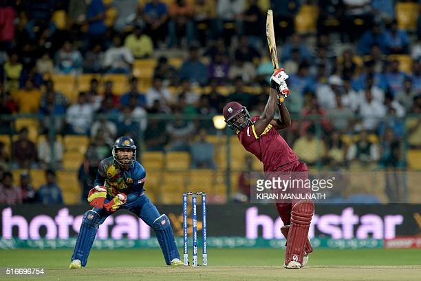 West Indies's Andre Fletcher plays a shot during the World T20 cricket tournament match between West Indies and Sri Lanka at the Chinnaswamy Stadium...