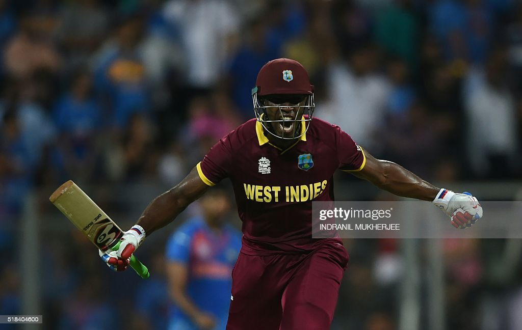 West Indies's Andre Russell celebrates after victory in the World T20 cricket tournament second semi-final match between India and West Indies at The Wankhede Stadium in Mumbai on March 31, 2016. / AFP / INDRANIL
