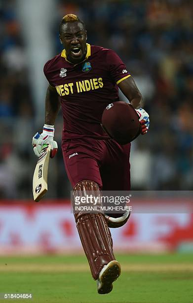 West Indies's Andre Russell celebrates after victory in the World T20 cricket tournament second semifinal match between India and West Indies at The...