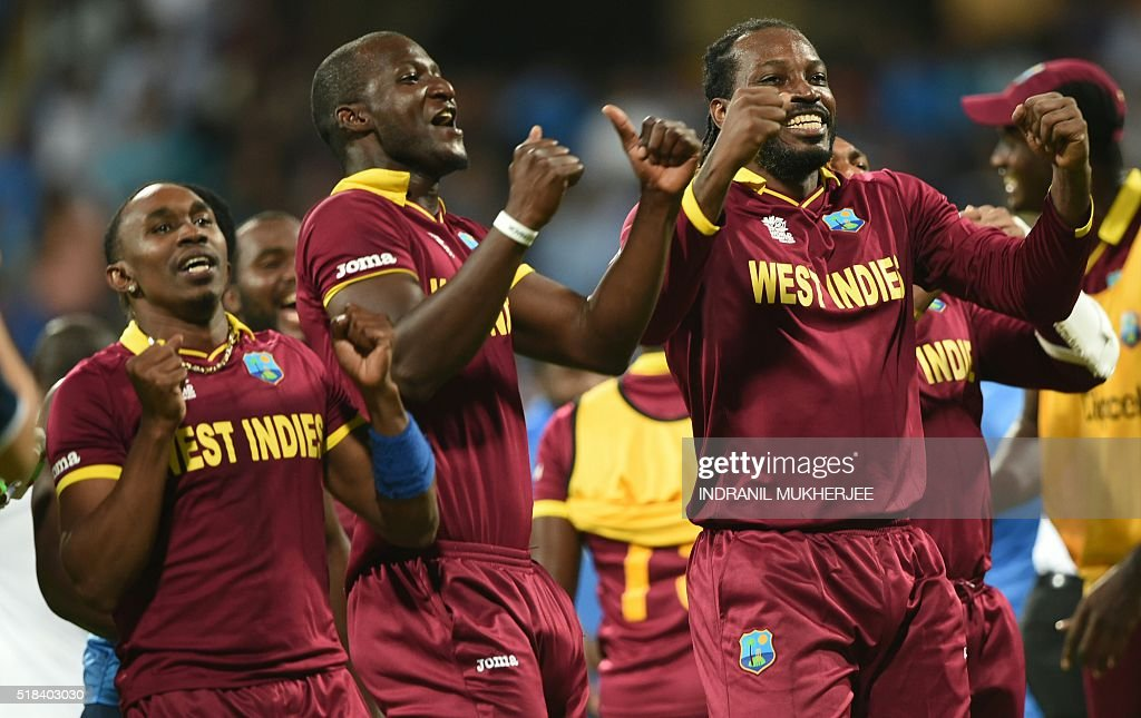West Indies's captain Darren Sammy(C) Dwayne Bravo(L)and Chris Gayle(R)celebrate after victory in the World T20 cricket tournament second semi-final match between India and West Indies at The Wankhede Stadium in Mumbai on March 31, 2016. / AFP / INDRANIL