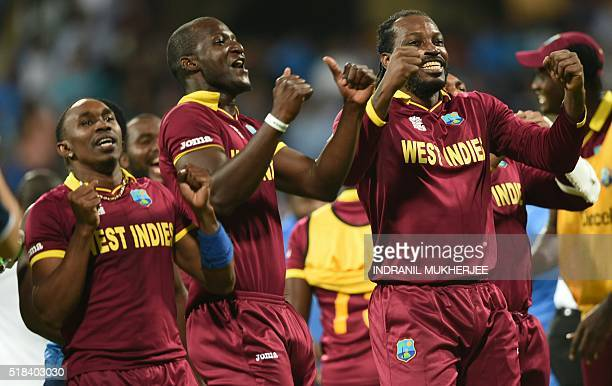 West Indies's captain Darren Sammy Dwayne Bravoand Chris Gaylecelebrate after victory in the World T20 cricket tournament second semifinal match...