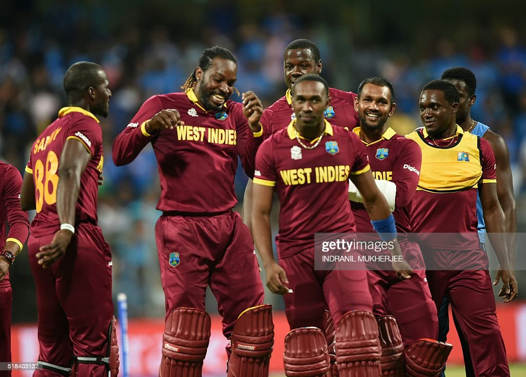 West Indies's captain Darren Sammy(L), Dwayne Bravo(C)and Chris Gayle(2L) lead teammates as they celebrate after victory in the World T20 cricket tournament second semi-final match between India and West Indies at The Wankhede Stadium in Mumbai on March 31, 2016. / AFP / INDRANIL