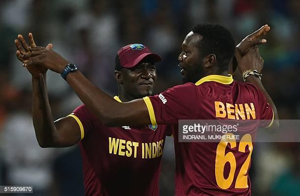 West Indies's captain Darren Sammyand Sulieman Benn celebrate the wicket of England batsman Alex Hales during the World T20 cricket tournament match...