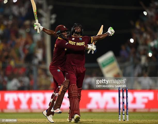 West Indies's Carlos Brathwaiteand teammate Marlon Samuels celebrate after victory in the World T20 cricket tournament final match between England...