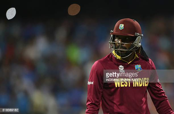 West Indies's Chris Gayle walks back to the pavilion after his dismissal during the World T20 semifinal match between India and West Indies at The...