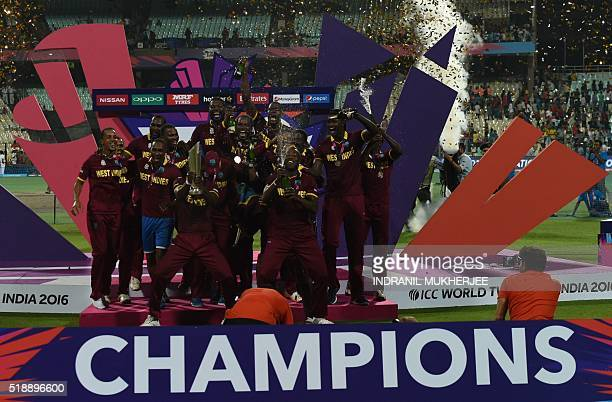 West Indies's cricketers celebrate after winning the World T20 cricket tournament final match between England and West Indies at The Eden Gardens...