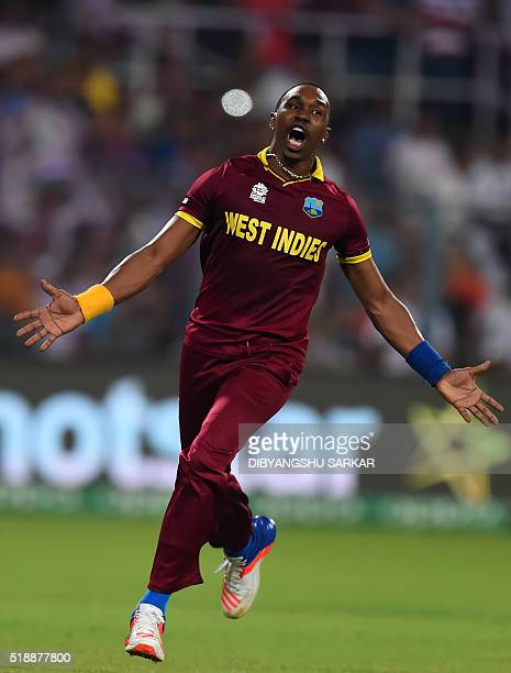 West Indies's Dwayne Bravo celebrates the wicket England's Moeen Ali during the World T20 cricket tournament final match between England and West...