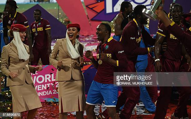 West Indies's Dwayne Bravo dances with air hostesses after victory in the World T20 cricket tournament final match between England and West Indies at...