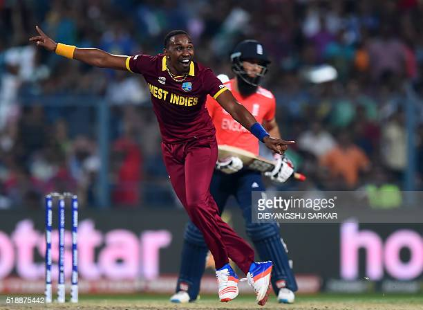 West Indies's Dwayne Bravocelebrates after the dismissal of England's Moeen Aliduring the World T20 cricket tournament final match between England...