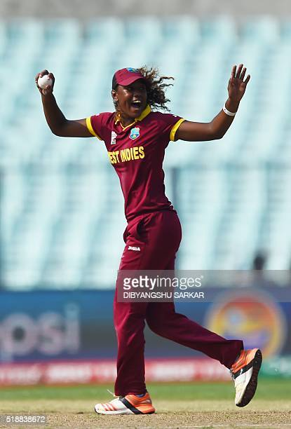 West Indies's Hayley Matthewscelebrates with teammates after the dismissal of Australia's Alyssa Healy during the World T20 cricket tournament...