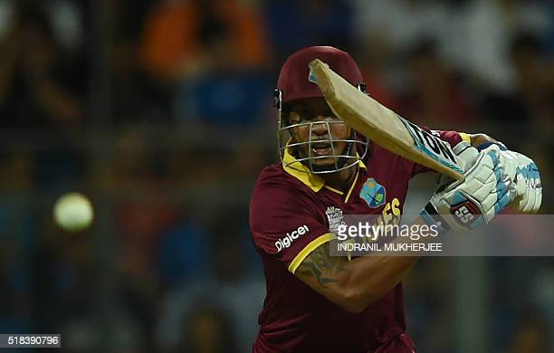 West Indies's Lendl Simmons plays a shot during the World T20 semifinal match between India and West Indies at The Wankhede Cricket Stadium in Mumbai...