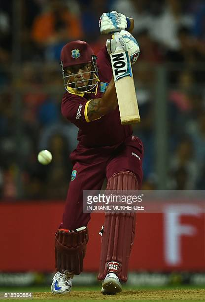 West Indies's Lendl Simmons plays a shot during the World T20 semi-final match between India and West Indies at The Wankhede Cricket Stadium in...