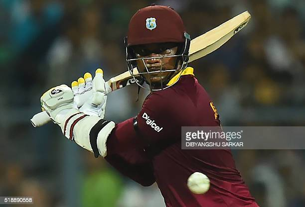 West Indies's Marlon Samuels plays a shot during the World T20 cricket tournament final match between England and West Indies at The Eden Gardens...