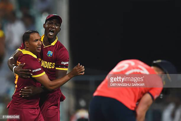 West Indies's Samuel Badreeand captain Darren Sammy celebrate after the dismissal of England's Jason Royduring the World T20 cricket tournament final...