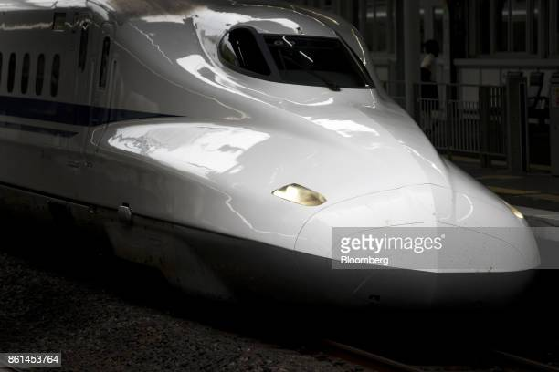 A West Japan Railway Co N700A Shinkansen bullet train travels through ShinKobe station in Kobe Hyogo Japan on Saturday Oct 14 2017 Kobe Steel Ltd's...