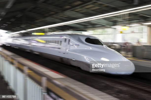 A West Japan Railway Co N700A Shinkansen bullet train travels through ShinKobe station in Kobe Hyogo Japan on Saturday Oct 14 2017 Kobe Steel Ltd's...