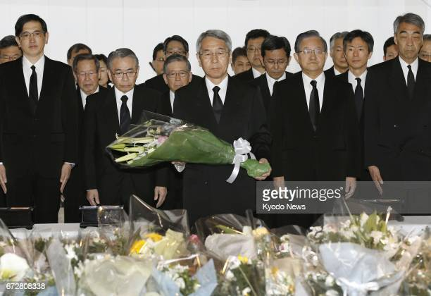 West Japan Railway Co President Tatsuo Kijima prepares to lay flowers in Amagasaki Hyogo Prefecture western Japan on April 25 the 12th anniversary of...