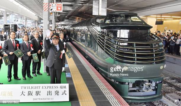West Japan Railway Co's Twilight Express Mizukaze luxury sleeper train prepares to depart on its first journey at JR Osaka Station in Osaka on June...