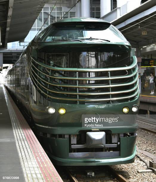 West Japan Railway Co's Twilight Express Mizukaze luxury sleeper train arrives at Osaka Station in the western Japan prefecture on June 13 2018...