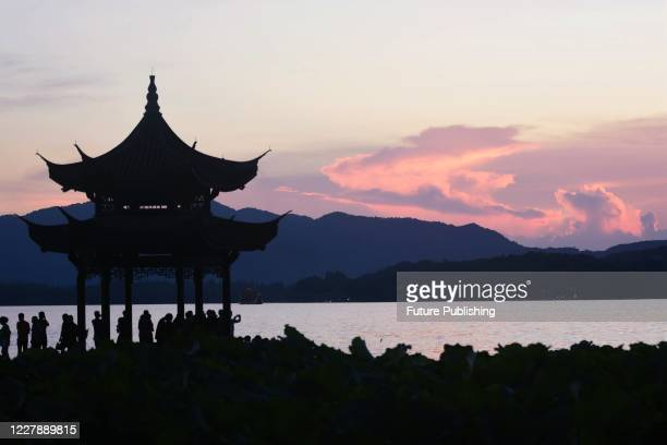 West Lake in summer sunset. Hangzhou city, Zhejiang Province, China, on the evening of 2 August 2020.- PHOTOGRAPH BY Costfoto / Barcroft Studios /...