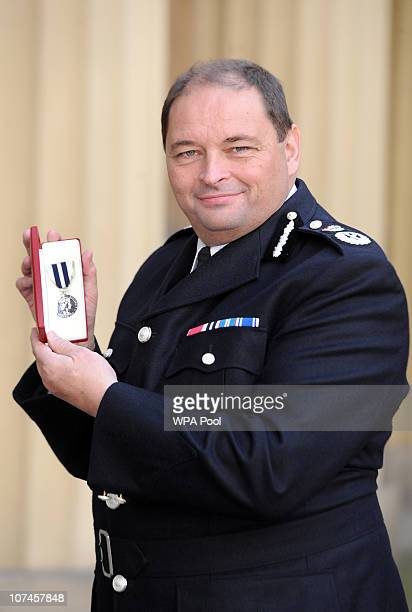 West Midlands Police Chief Constable Christopher Sims poses with his Queen's Police Award presented to him by Prince Charles Prince of Wales during...