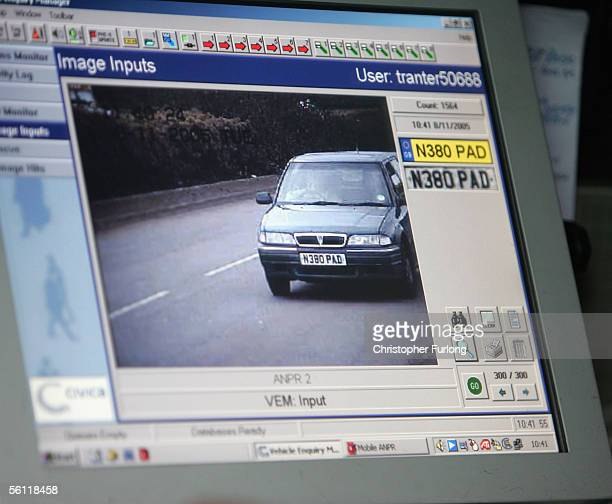 West Midlands Police use a number plate recognition camera during a crackdown on uninsured drivers on November 8 2005 in Birmingham England A...