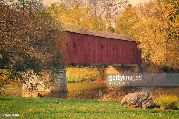 west montrose covered bridge - covered bridge stock photos and pictures