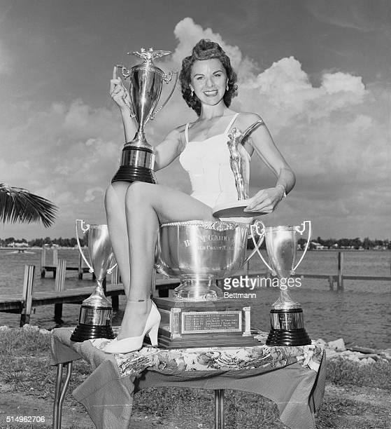 West Palm Beach Florida In Her Cups A smiling Mary Clare Queen of the Gold Coast Marathon displays the trophies that will be awarded to the winning...