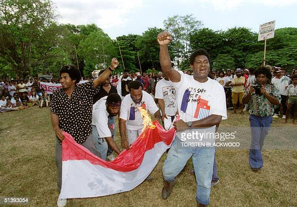 West Papuan activists led by Richard Limah burn 14 September 1995 the Indonesian flag outside the venue of the 26th South Pacific Forum in Madang A...