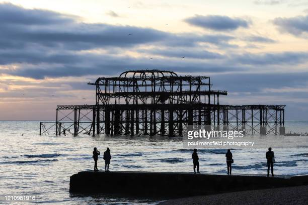 west pier at sunset - mansfield england stock pictures, royalty-free photos & images