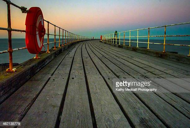 west pier at twilight - kathy west stock pictures, royalty-free photos & images