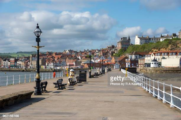 west pier at whitby, north yorkshire, england - whitby north yorkshire england stock photos and pictures