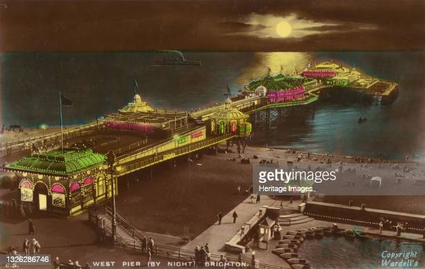 West Pier by night, Brighton, 1939. The West Pier in Brighton, Sussex, was completed in 1866, closed in 1975, and has since collapsed due to storms...