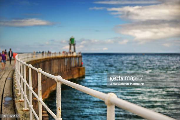 west pier, whitby harbour - pier stock pictures, royalty-free photos & images