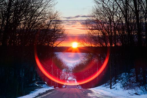 West Pine Drive spring equinox lens flare sunrise 936359972