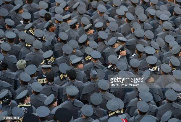 West Point cadets watch the ArmyNavy football game hosted at the MT Bank Stadium in Baltimore Maryland on December 10 2016 US Presidentelect Donald...