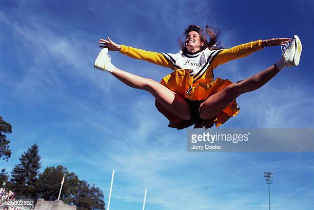 West Point Cheerleader Leaping in Air