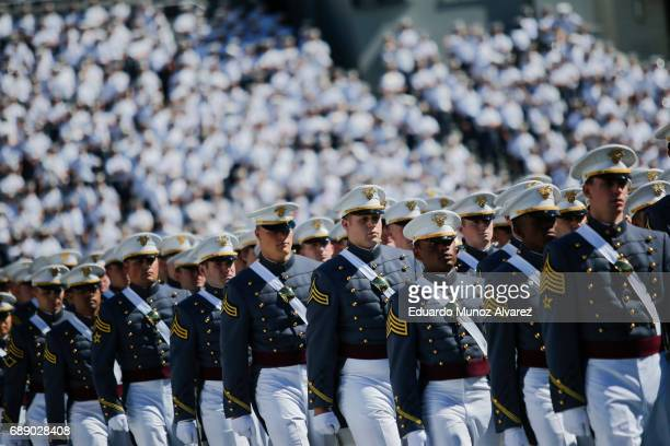 West Point graduates arrive to the US Military Academy Class of 2017 graduation ceremony at Michie Stadium on May 27 2017 in West Point New York US...