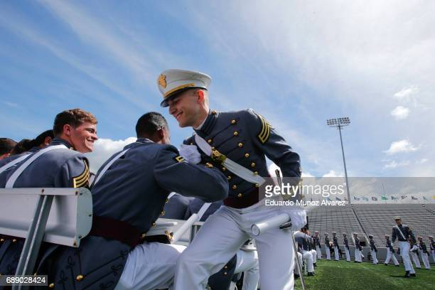 West Point graduates celebrate during the U.S. Military Academy Class of 2017 graduation ceremony at Michie Stadium on May 27, 2017 in West Point,...
