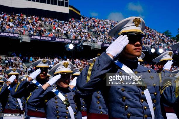 West Point graduates salute during the US Military Academy Class of 2017 graduation ceremony at Michie Stadium on May 27 2017 in West Point New York...